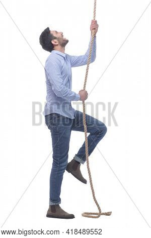ambitious young man climbing a rope. isolated on a white background.