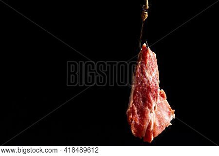 Fishing Hook With Bait. A Piece Of Raw Meat On A Hook. The Bait Is Trapped.