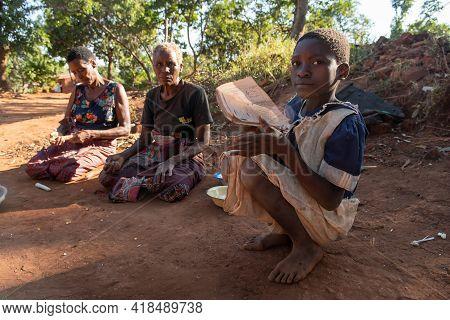 Mzuzu, Malawi. 30-05-2018. Portrait Of A Serious Black Girl Reading Her School Homework In The Compa