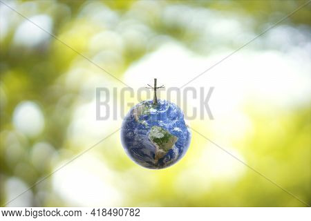 Planet Earth Globe Ball And Growing Tree On Green Sunny Blurred Background. Saving Environment, Save