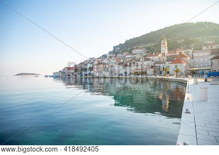 Vis, Croatia - 31.03.2021: View From Water Of Mediterranean Town Vis Without Tourists In Sunrise. Ya