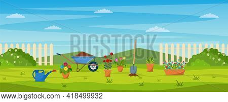 Garden With Green Grass, Flowers, Garden Wheelbarrow, Shovel. Garden Concept. Banner With Spring Or
