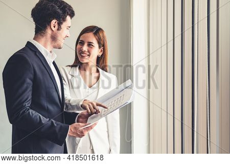 Businessman Executive Is In Meeting Discussion With Businesswoman Or Client In Modern Workplace Offi