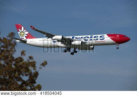Edelweiss Airbus A 340 313x Aircraft On The Final Approach To The International Airport In Zurich In