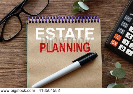 Estate Planning. Lies On A Wooden Background, A Notebook With Craft Pages. Text On Notepad.