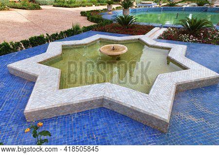 Moorish Fountain In The Jnan Sbil City Park In Fez. Morocco.