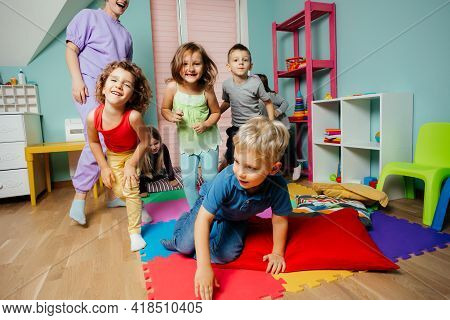 Happy Kids Actively Playing At The Daycare