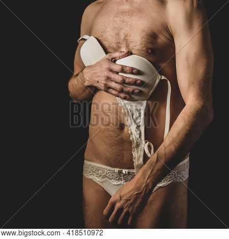 Bisexual Young Man In White Lace Womens Lingerie On Dark Background