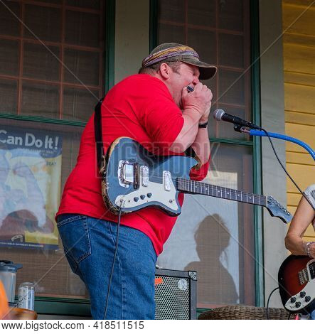 New Orleans, La - November 14: Harmonica Player For 30 X 90 Band Performs At Front Porch Concert In