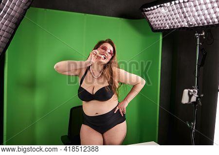 Standing Woman In Bikini Biting Off Lollipop