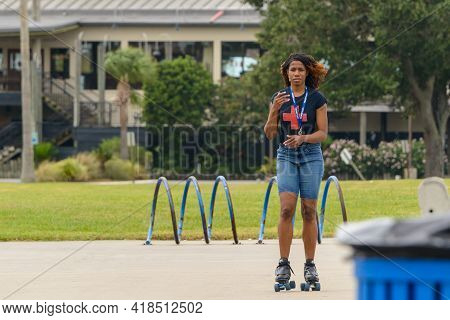 New Orleans, La, Usa - October 9: Young Woman Roller Skates Along The Lakefront On October 9, 2020 I