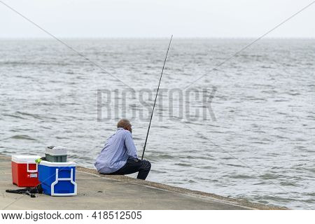New Orleans, La  - October 9: Elderly Man Fishes On Lake Pontchartrain On October 9, 2020 In New Orl