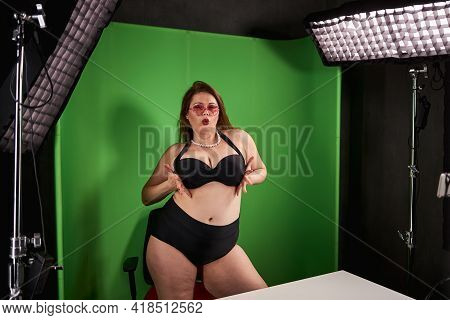 Fat Lady In Underwear Pressing Her Breasts To Each Other