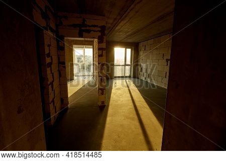 Unfinished Empty Flat, Two Huge Plastic Windows, Walls Made Of Aerated Concrete Blocks, Cement Scree