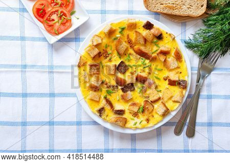 Omelet With  Pieces Of Bread And Cheese. Delicious And Nutritious Breakfast. Top View.
