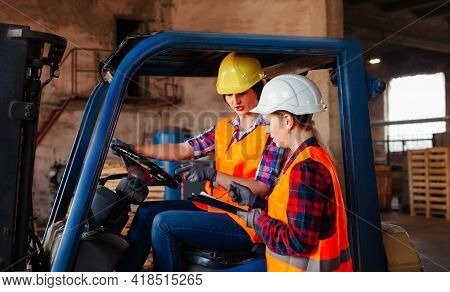 Young Female Warehouse Workers Solving Working Issues