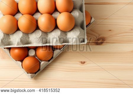 Eggs In Cardboard Box With Second Cardboard With Eggs At The Top Of It On The Wooden Table Backgroun
