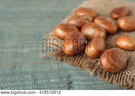 Raw Jackfruit Seeds And Sackcloth On Light Blue Wooden Table, Closeup. Space For Text
