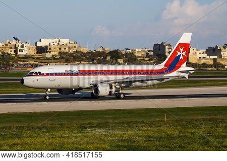 Luqa, Malta - December 4, 2016: Air Malta Passenger Plane At Airport. Schedule Flight Travel. Aviati