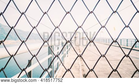 Chainlink Fence. Wire Fence. Metal Net. Wire Mesh. Metal Grater Grille Background.