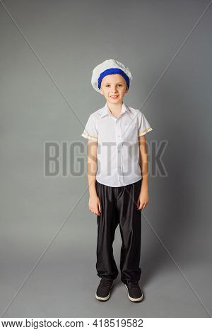 The Little Boy Dressed In A Sailor Uniform