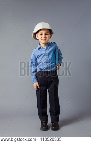 The Little Boy With Tablet Dressed In A Costume Of Engineer
