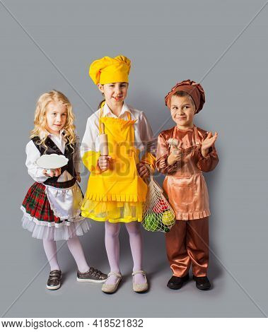 The Little Kids In Costume Of Chef And Waiter