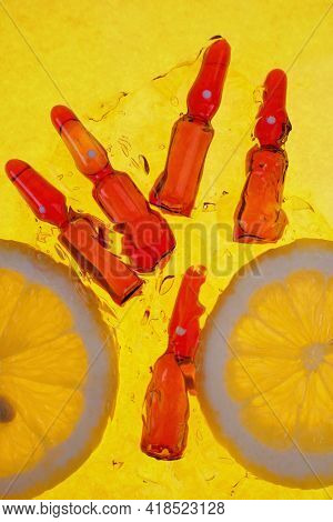 Vitamin C. Serum With Vitamin C.vitamins For Beauty And Health. Glass Ampoules Set And Lemons Slices
