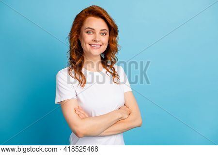Photo Portrait Of Confident Girl With Folded Arms Isolated On Pastel Blue Colored Background