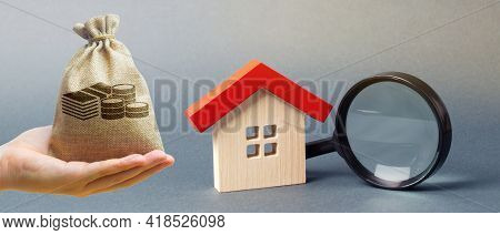 Money Bag, Miniature House And Magnifying Glass. Home Appraisal. Property Valuation. Choice Of Locat