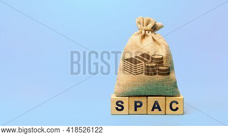 Wooden Blocks With The Word Spac And Money Bag - Special Purpose Acquisition Company. Simplified Lis