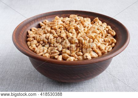 Delicious Airy Wheat In Honey Glaze In A Clay Bowl