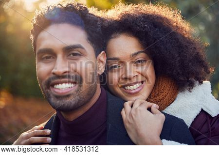 Portrait Of Loving Young Couple Hugging Outdoors In Fall Or Winter Countryside