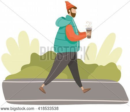 Man Walking In Forest Or Park Alone. Guy Drinking Coffee While Walking In Cold Weather. Person In Wa
