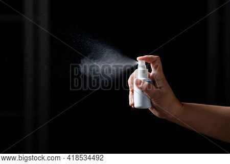 Close Up Hand Of  Portable Alcohol Spraying Antibacterial Sanitizing Spray Bottle Disinfecting Again