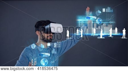 Composition of data processing and people icons over man wearing vr headset touching screen. global connection, virtual reality and technology concept digitally generated image.