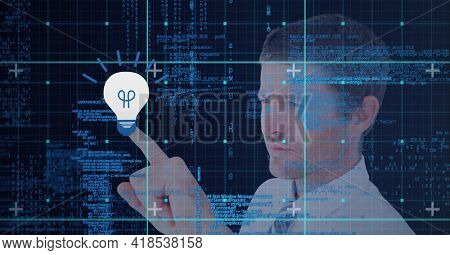 Composition of man touching virtual screen with light bulb icon and data processing. global connections, data processing and technology concept digitally generated image.