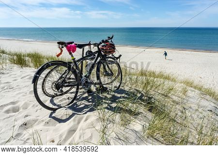Kaliningrad Region, Baltic Sea, Russia, May 10, 2020. Two Bicycles On The Seashore. Walking On The S