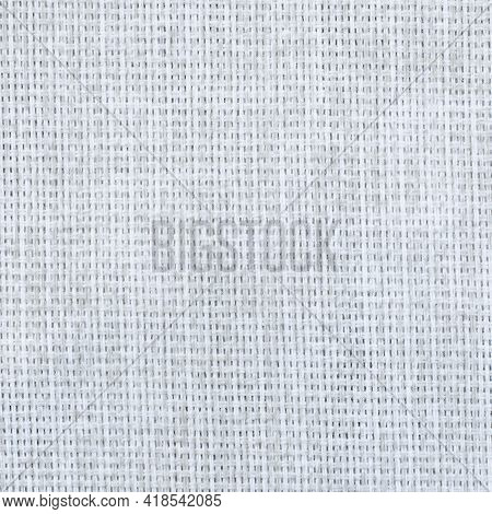 Texture Of Natural Linen Fabric Close Up. Gray White Linen Textile