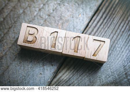 B117 Sars-cov-2 Mutation Written On Wooden Blocks On A Board