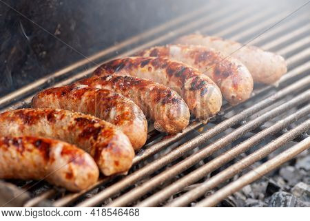 Delicious Grilled Sousages. Barbiquing Sousages On Hot Grill.