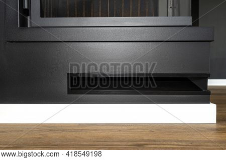 Air Intake In A Modern Fireplace With A Closed Combustion Chamber Standing In The Living Room, Paint