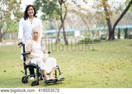 Doctor Help And Care Asian Senior Or Elderly Old Lady Woman Patient Sitting On Wheelchair At Nursing