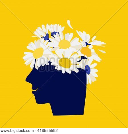 Mental Health Concept. Abstract Image Of A Head With Flowers Inside. Chamomile, Flowers And Leaves A