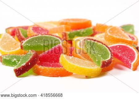 The Background Consists Of Many Delicious Sweet Colored Marmalades In The Form Of Fruit Slices.fruit