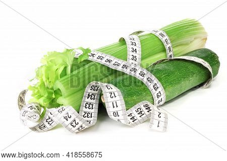 Celery Zucchini And Measure Tape Diet Weight Loss Concept Isolated On White Background