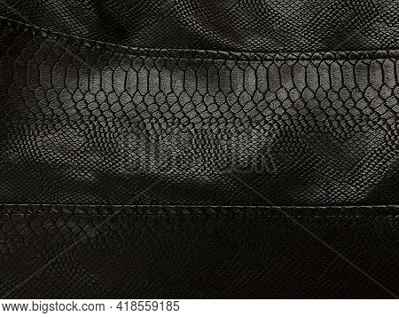 Black Leather Material, Part Of Clothes, Leather Jacket, Large Seams. Artificial Leather Looks Like