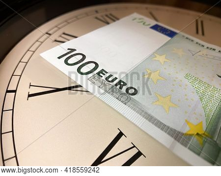 One Hundred Euros Is On The Watch, Clock, The Dial With Roman Numerals. Time Is Money