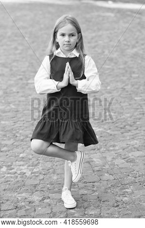 Meditate To Develop Mental Muscles. Little Child In Uniform Meditate Outdoors. Small Kid Balance On