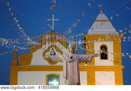 Porto Seguro, Bahia, Brazil - June 9, 2007: Christ Sculpture Is Seen Facing The Parish Church Nossa